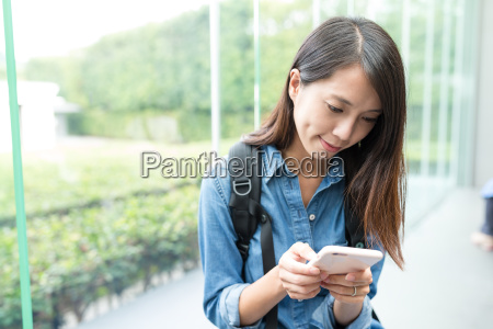 asian woman looking at the cellphone