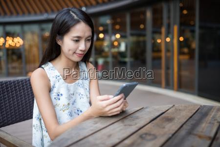 asian woman using mobile phone at
