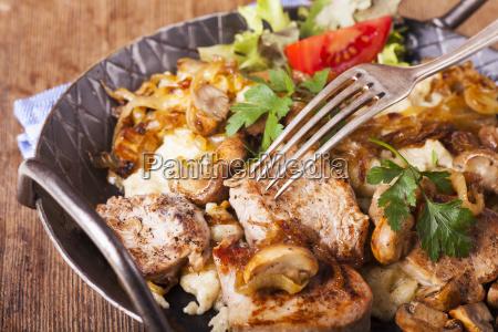 pork fillet on spaetzle with mushrooms