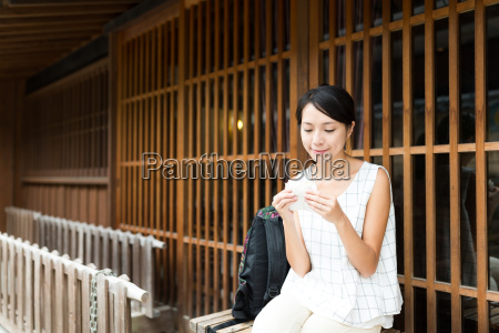 asian woman enjoy the japanese snack