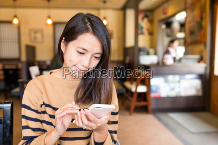 woman using mobile phone in japanese