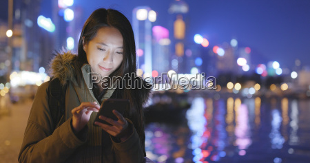 asian woman using cellphone in hong