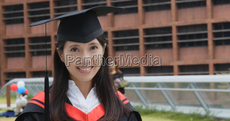 asian woman with graduation gown