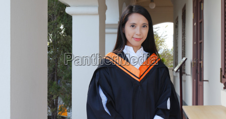 asian woman with graduation gown in