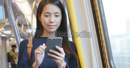 woman use of mobile phone inside