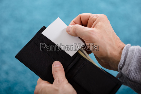person removing card from wallet