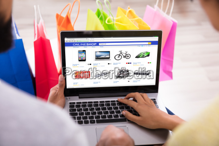 couple shopping online in front of