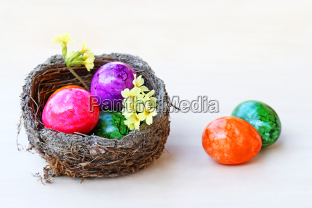 an easter basket with colorful easter