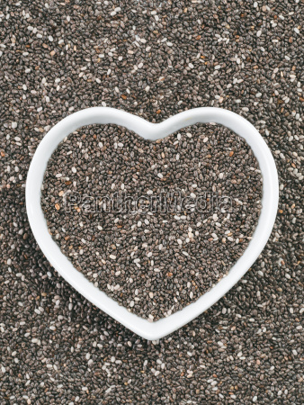 heart shaped bowl of chia seeds