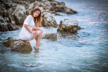 pretty young woman on a beach