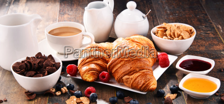 breakfast served with coffee croissants cereals
