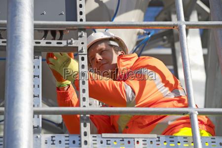 engineer wearing hi viz protective clothing