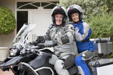 portrait of happy senior couple wearing