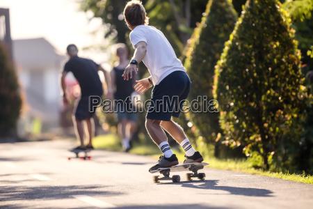 young man skateboarding in street canggu
