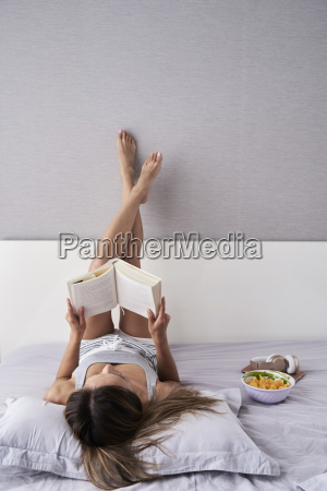 relaxed woman reading a book in
