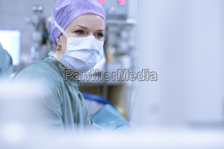 surgeon in scrubs during an operation