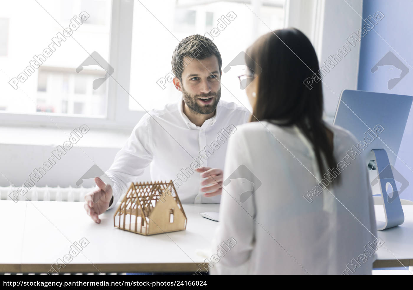 man, explaining, architectural, model, to, woman - 24166024