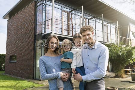 portrait of smiling family in front