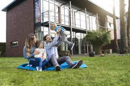 happy family on blanket in garden