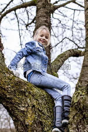 young beautiful girl is climbing on