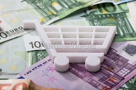 shopping cart on euro banknotes