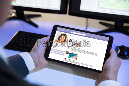 businessperson using social networking site on