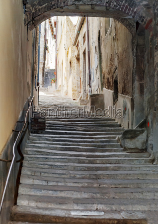 ancient staircase with an arch in