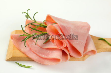 thin slices of ham and rosemary
