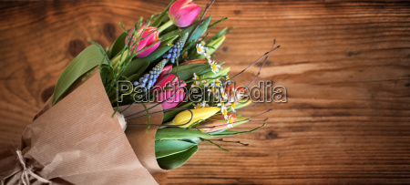 colorful spring bouquet on dark rustic