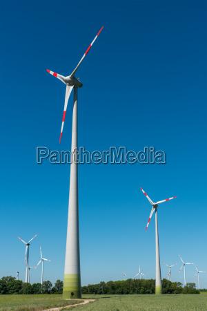 wind turbines seen in front of