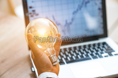 business hand holding light bulb concept