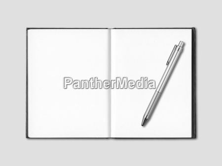 blank open notebook and pen isolated