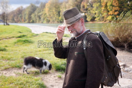 bavarian man by the river with