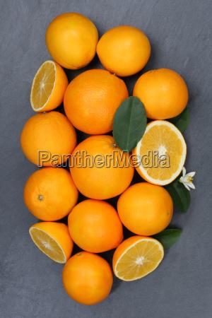 orangen orange frucht fruechte hochformat schieferplatte
