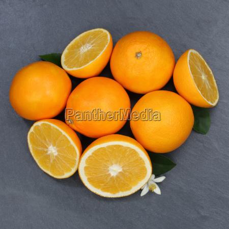 orangen orange frucht fruechte quadrat schieferplatte