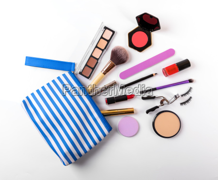 makeup bag with cosmetics on white