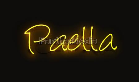 close up paella yellow neon light