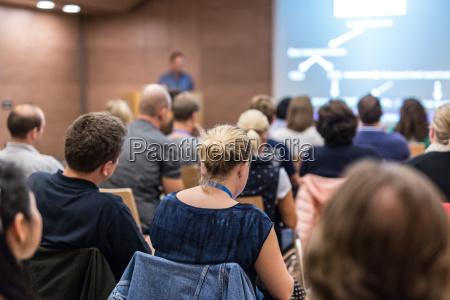 speaker giving presentation on health care