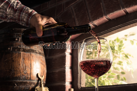 sommelier pouring wine into a glass