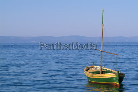 sailboat moored in port on the