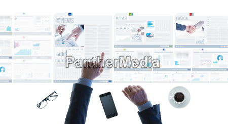 businessman pointing at financial reports and