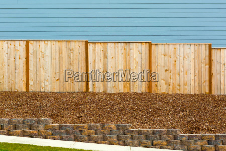 new garden wood fence by house