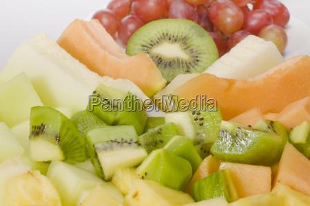 aufgeschnittene exotische fruchte zuckermelone