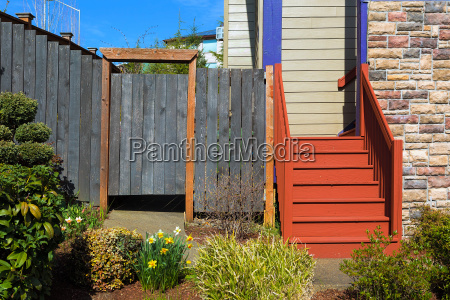 house frontyard with wood stairs and