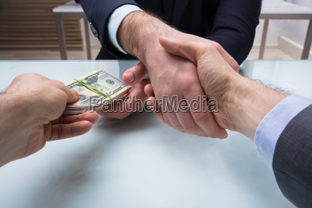 two business partners shaking hand at