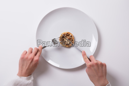 womans hand with fresh food on