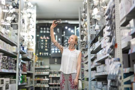 woman using smart phone to take