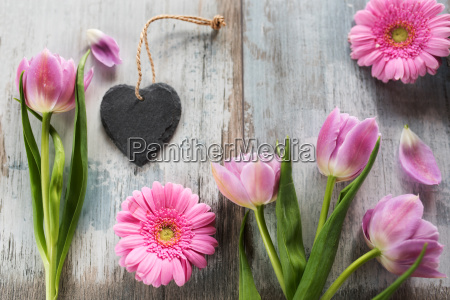 pink flowers with a heart on