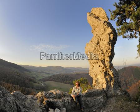 woman in front of arnstein rock