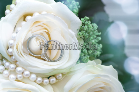 wedding jewelry and white roses